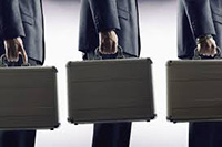 three men standing in queue holding briefcases