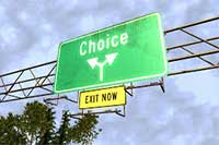 green sign with choice and an arrow, yellow sign with exit now