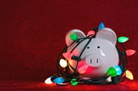 piggy bank covered in christmas lights